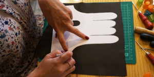 Riina O glove making