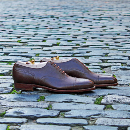 profile shot of brown oxford shoes