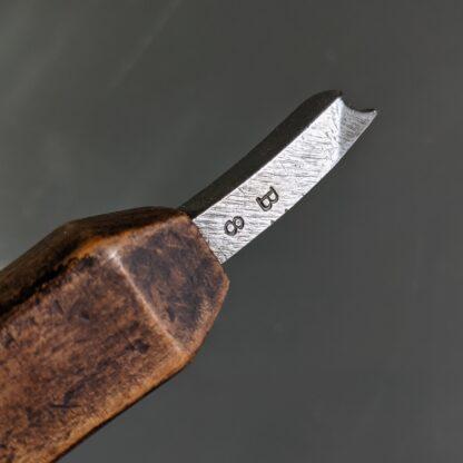 detail of waist iron